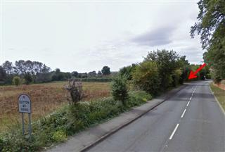 As you enter Sutton-at-hone from Darenth the car park entrance is on the left just as the road bends